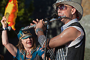 Flutist playing solo, March Fourth Marching Band performance at 2011 Bumbershoot, Seattle Center, Seattle, Washington, USA