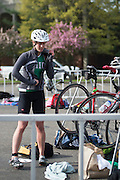 Anna Moore, an Ohio University senior, changes and stretches after completing the biking route for the Race for a Reason triathlon, Saturday, April 27, 2013. Race for a Reason, Race 4 A Reason, Annual Events, Events, Students, Faculty & Staff