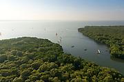 The Island from Above. Fishing Catamarans heading for sea. Morning. Negombo Lagoon.