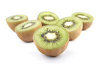 Studio shot of halved kiwis on white background
