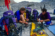 Climbers prepare gear base camp  on 7300m peak 1st ascent Chongtar, Karakoram Mts, far western China, Central Asia