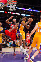 22 March 2013: Center (12) Dwight Howard of the Los Angeles Lakers grabs a rebound against the Washington Wizards during the second half of the Wizards 103-100 victory over the Lakers at the STAPLES Center in Los Angeles, CA.