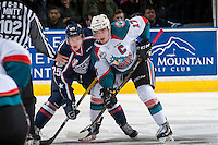KELOWNA, CANADA - MARCH 4: Rodney Southam #17 of the Kelowna Rockets checks Kyle Olson #25 of the Tri-City Americans after the face off during first period on March 4, 2017 at Prospera Place in Kelowna, British Columbia, Canada.  (Photo by Marissa Baecker/Shoot the Breeze)  *** Local Caption ***