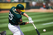 Oakland Athletics right fielder Stephen Piscotty (25) makes contact with a pitch against the San Francisco Giants at Oakland Coliseum in Oakland, California, on March 25, 2018. (Stan Olszewski/Special to S.F. Examiner)