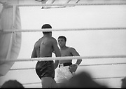 Ali vs Lewis Fight, Croke Park,Dublin.<br /> 1972.<br /> 19.07.1972.<br /> 07.19.1972.<br /> 19th July 1972.<br /> As part of his built up for a World Championship attempt against the current champion, 'Smokin' Joe Frazier,Muhammad Ali fought Al 'Blue' Lewis at Croke Park,Dublin,Ireland. Muhammad Ali won the fight with a TKO when the fight was stopped in the eleventh round.<br /> <br /> Photograph taken as both fighters size each other up.