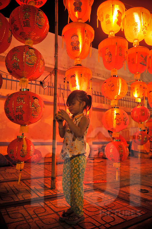 During Tet festival, red chinese lanterns lighted by night in a street of Nha Trang, Vietnam, Asia