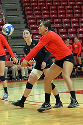 28 September 2014:  Ashley Rosch, Emily Orrick and Stacey Niao during an NCAA womens volleyball match between the Evansville Purple Aces and the Illinois State Redbirds at Redbird Arena in Normal IL