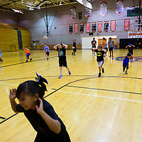 Participants of a basketball camp preform exercises down the court at Gallup High School on June 7, 2017<br /> .