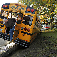 Adam Robison | BUY AT PHOTOS.DJOURNAL.COM <br /> Curtis Hinton, shop forman at the Lee County Schools Bus Shop, exits the rear of the school bus after securing the inside after it ran off the shoulder of Green Tee Road Wednesday afternoon.