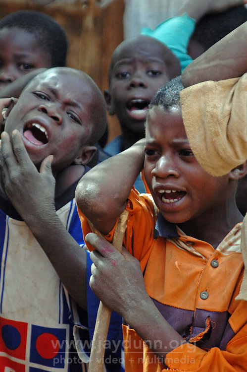 BURKINA FASO, Bani, 2007. The call and response of Bani's Muslim devotional singing requires almost constant attention, and these boys give it all they can.