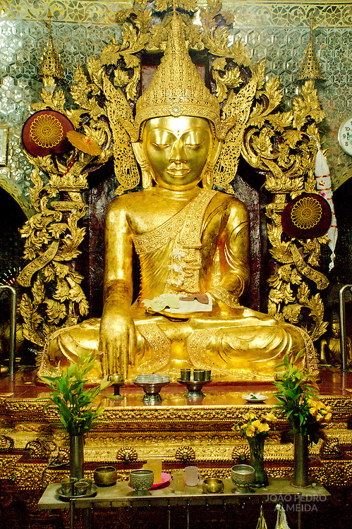Golden statue inside small temple at Mandalay