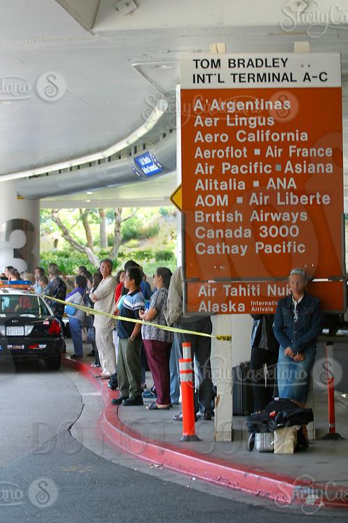 Jul 04, 2002; Los Angeles, CA, USA; Stranded passengers at Los Angeles International airport near the Tom Bradley International terminal. <br />Mandatory Credit: Photo by Shelly Castellano/ZUMA Press.<br />(&copy;) Copyright 2002 by Shelly Castellano