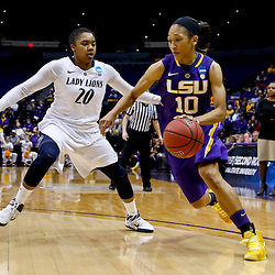 Mar 26, 2013; Baton Rouge, LA, USA; LSU Tigers guard Adrienne Webb (10) drives past Penn State Lady Lions guard Alex Bentley (20) in the first half during the second round of the 2013 NCAA womens basketball tournament at Pete Maravich Assembly Center. Mandatory Credit: Derick E. Hingle-USA TODAY Sports
