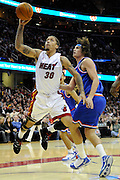 Feb 4, 2010; Cleveland, OH, USA; Miami Heat forward Michael Beasley (30) shoots over Cleveland Cavaliers forward Anderson Varejao (17) during the second quarter at Quicken Loans Arena. Mandatory Credit: Jason Miller-US PRESSWIRE