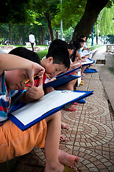 Vietnamese kids during a drawing class, Hoan Kiem Lake, Hanoi, Vietnam, Southeast Asia