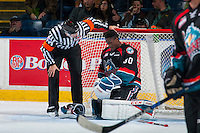 KELOWNA, CANADA - OCTOBER 26: Referee Kevin Bennett checks in with Michael Herringer #30 of the Kelowna Rockets after a collision with a player of the Victoria Royals on October 26, 2016 at Prospera Place in Kelowna, British Columbia, Canada.  (Photo by Marissa Baecker/Shoot the Breeze)  *** Local Caption ***