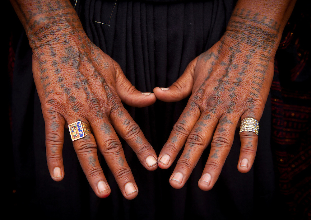 Tattoos on the hands of a Rabari woman, Maha Kumbh Mela festival, world's largest congregation of religious pilgrims. Allahabad, India.