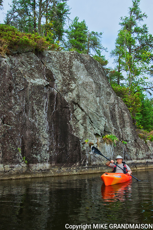 Kayaking on Blindfold Lake by the cliffs<br />
