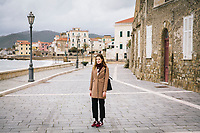 SANTA MARIA DI CASTELLABATE (CASTELLABATE), ITALY - 14 FEBRUARY 2018: Alessia d'Alessandro (28), the Five Stars Movement (M5S, Movimento 5 Stelle) candidate running for the Chamber of Deptuies in the 2018 Italian General Elections, poses for a portrait in Santa Maria di Castellabate, where she spent her weekends and summers between the age of 14 and 18, on February 14th 2018.<br /> <br /> Santa Marina di Castellabate is part of the electoral college of Agropoli, in the Campania region (southern Italy) in which Franco Alfieri (Democratic Party, PD, Partito Democratico), politically active for the past 30 years, is running agains the 28-years old Alessia d'Alessandro (Five Stars Movement, M5S, Movimento 5 Stelle).<br /> <br /> The 2018 Italian general election is due to be held on 4 March 2018 after the Italian Parliament was dissolved by President Sergio Mattarella on 28 December 2017.<br /> Voters will elect the 630 members of the Chamber of Deputies and the 315 elective members of the Senate of the Republic for the 18th legislature of the Republic of Italy, since 1948.Santa<br /> <br /> The 2018 Italian general election is due to be held on 4 March 2018 after the Italian Parliament was dissolved by President Sergio Mattarella on 28 December 2017.<br /> Voters will elect the 630 members of the Chamber of Deputies and the 315 elective members of the Senate of the Republic for the 18th legislature of the Republic of Italy, since 1948.