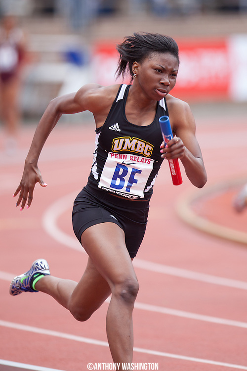 Mercedes Jackson of UMBC runs the anchor leg during the College Women's 4x100 (Heats)at the Penn Relays athletic meets on Thursday, April 26, 2012 in Philadelphia, PA.