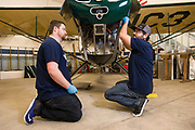 Kyle Bushman and Joshua Knowlton of Ragwood Refactory working on restoring an Interstate Cadet.