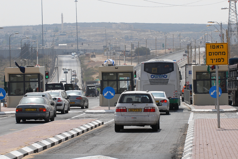 A new Israeli-controlled checkpoint at Route 443 in the West Bank on the outskirts of Jerusalem on may 28, 2010. Route 443 had been closed off by Israel to Palestinian vehicles since 2002 after a series of shooting attacks on Israeli vehicles. The Israeli Supreme court issued an order allowing Palestinian drivers to start using certain parts of road 443 starting today. The road cuts through the occupied West Bank and links Jerusalem and Israel's coastal plain. Photo by GILI YAARI