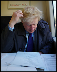 The London Mayor Boris Johnson working on the train to Croydon where he will launch his economy manifesto, April 4, 2012. Photo By Andrew Parsons/ i-Images...