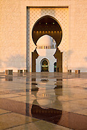 Domed arch with reflection at the Sheikh Zayed Grand Mosque, Abu Dhabi, UAE