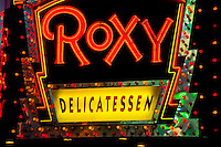 New York, New York City. Neon sign for the Roxy Delicatessen.