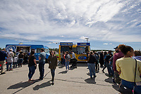 Folks lined up at Somerset Grill and Tator Tots and Tacos from Kimberly's Kitchen during the Exit 20 Food Truck Festival at Tanger Outlet's on Saturday afternoon.  (Karen Bobotas/for the Laconia Daily Sun)