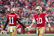 San Francisco 49ers quarterback Jimmy Garoppolo (10) and San Francisco 49ers wide receiver Marquise Goodwin (11) shake hands in between plays against the Jacksonville Jaguars at Levi's Stadium in Santa Clara, Calif., on December 24, 2017. (Stan Olszewski/Special to S.F. Examiner)