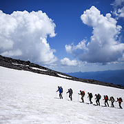 Climbers make their way up the Muir Snowfield on the southeast face of Mount Rainier on June 30, 2015. The iconic Pacific Northwest volcano is a popular challenge for mountaineers.  (Joshua Trujillo, seattlepi.com)