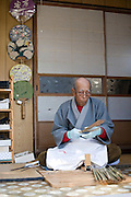 Masao Uyama makes Boshu Uchiwa fans at his atelier in Tateyama, Chiba Prefecture, Japan. Uyama had been making the traditional bamboo fans for 67 years before his passing in 2017. Photographer: Rob Gilhooly