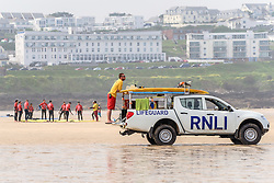 A RNLI Lifeguard on duty at Fistral Beach in Newquay, Cornwall.