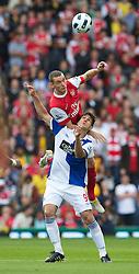 BLACKBURN, ENGLAND - Saturday, August 28, 2010: Arsenal's Thomas Vermaelen and Blackburn Rovers' Nikola Kalinic during the Premiership match at Ewood Park. (Pic by: David Rawcliffe/Propaganda)