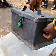 "The cashbox of a women's ""susu"" group - an informal savings and loan club - in the village of Gbengbee in the Upper West region of Ghana. The women's activities are supported by Pognaa Tang I - a pognaa is responsible, in particular, for the wellbeing of women and children in her area of authority. While the title translates as ""woman chief"", in practice her authority is  subject to a male chief. The role of the pognamine (plural of pognaa) is being revived after having been suppressed during the colonial era, and they are increasingly seen as a force for development."