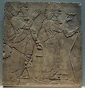 Relief : King Ashurnasirpal II and genius 9th Century BC Kalchu (Nimrud, northern Iraq) alabaster.