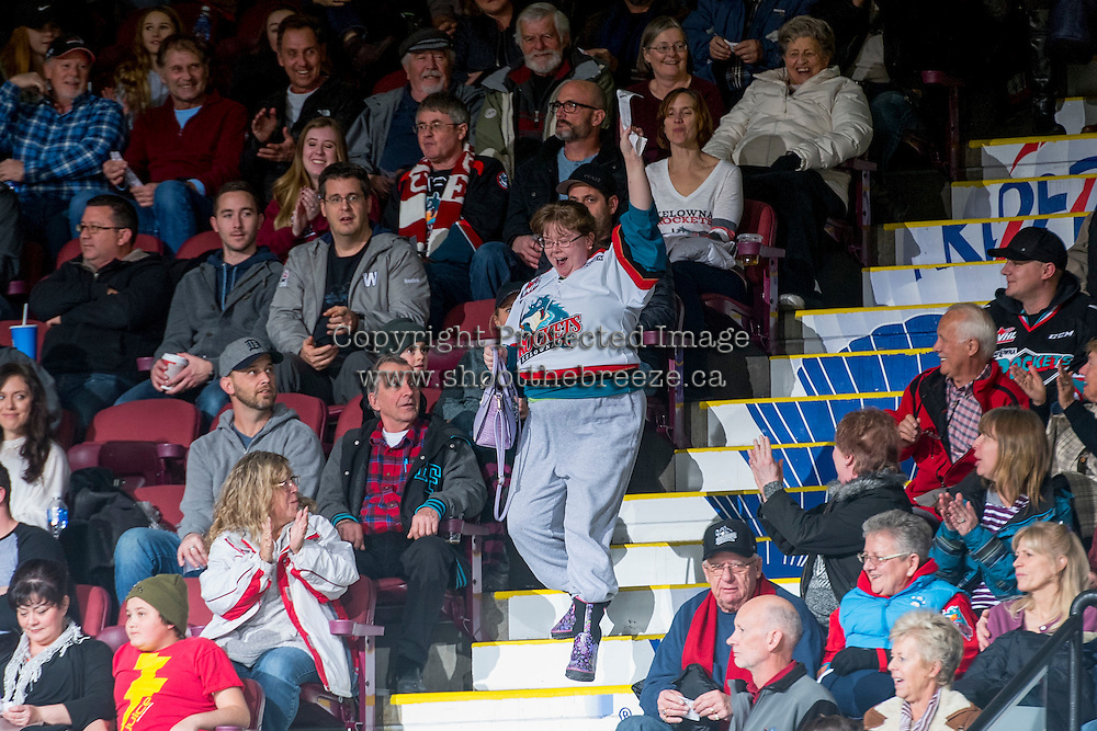 KELOWNA, CANADA - DECEMBER 27: A fan celebrates winning the 50/50 jackpot on December 27, 2016 at Prospera Place in Kelowna, British Columbia, Canada.  (Photo by Marissa Baecker/Shoot the Breeze)  *** Local Caption ***