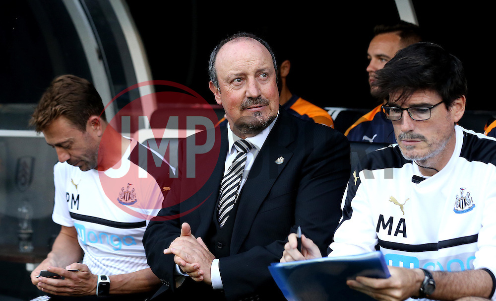 Rafa Benitez manager of Newcastle United takes his seat and rubs his hands ahead of his sides first Sky Bet Championship fixture of the season against Fulham - Mandatory by-line: Robbie Stephenson/JMP - 05/08/2016 - FOOTBALL - Craven Cottage - Fulham, England - Fulham v Newcastle United - Sky Bet Championship