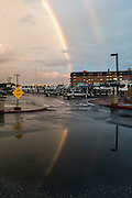 """Annapolis, Maryland - June 05, 2016: A rainbow is reflected in a sizable puddle on Dock Street -- an example of nuisance flooding -- in Historic Annapolis, Md., Sunday June 5th, 2016. Annapolis is one of the most prone cities in the U.S. to nuisance flooding. <br /> <br /> <br /> A perigean spring tide brings nuisance flooding to Annapolis, Md. These phenomena -- colloquially know as a """"King Tides"""" -- happen three to four times a year and create the highest tides for coastal areas, except when storms aren't a factor. Annapolis is extremely susceptible to nuisance flooding anyway, but the amount of nuisance flooding has skyrocketed in the last ten years. Scientists point to climate change for this uptick. <br /> <br /> <br /> CREDIT: Matt Roth for The New York Times<br /> Assignment ID: 30191272A"""