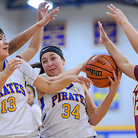 Valley Sanders Pirate Mariah Soria (34) grabs a rebound away from the Rough Rock Sun Devils Wednesday at Valley Sanders High School.