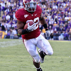 November 6, 2010; Baton Rouge, LA, USA; Alabama Crimson Tide running back Mark Ingram (22) runs for a touchdown during the second half against the LSU Tigers at Tiger Stadium. LSU defeated Alabama 24-21.  Mandatory Credit: Derick E. Hingle