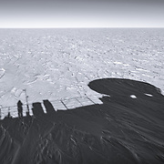 Adrift on a frozen sea of ice atop the Dark Sector Lab, South Pole. The ice is about 9,000 ft thick at the Pole, and it's slowly moving toward the ocean 800+ miles away at about 1 inch per day.