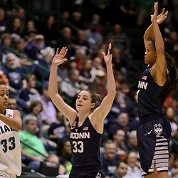 Feb 3, 2016; New Orleans, LA, USA; Tulane Green Wave guard Courtnie Latham (33) is defended by Connecticut Huskies guard/forward Katie Lou Samuelson (33) and guard Moriah Jefferson (4) during the first quarter of a game at the Devlin Fieldhouse. Mandatory Credit: Derick E. Hingle-USA TODAY Sports