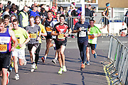 Runners at the final bend during The Great South Run in Southsea, Portsmouth, United Kingdom on 23 October 2016. Photo by Jon Bromley.