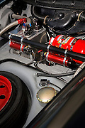 Image of a hot rod interior front trunk with gas tank, shock reservoirs, oil tank, fire extinguisher, and spare wheel and tire,  Porsche 911 RSR, California, America west, property released