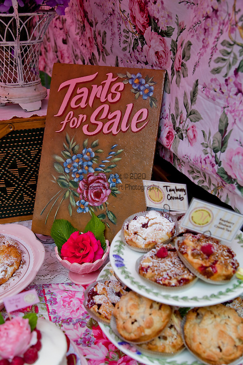 The extremely popular Saturday Portland Farmers' Market, located in the South Park Blocks near the Portland State University Campus, offers a large selection of locally grown organic produce, fish, meat and foodstuffs.  Pictured here are freshly made tarts by the Market Gourmet who travel to the market from Hood River, OR.