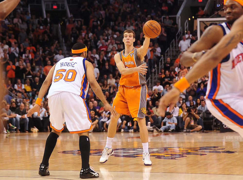 Mar. 26 2010; Phoenix, AZ, USA; Phoenix Suns guard Goran Dragic (2) makes a pass against New York Knicks guard Eddie House (50) in the second half at the US Airways Center.  The Suns defeated the Knicks 132-96.  Mandatory Credit: Jennifer Stewart-US PRESSWIRE.