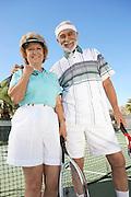Happy Couple on the Tennis Court