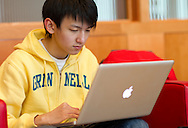 Tinggong Zhan, 19 years old, freshman, of Zibo, China studies on his computer at Grinnell College in Grinnell, Iowa on Tuesday February 1, 2011.
